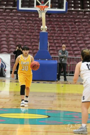 Senior Jaydan Garcia dribbles the ball down the court at the Events Center. (Photo Courtesy of Bob Sprouse.)